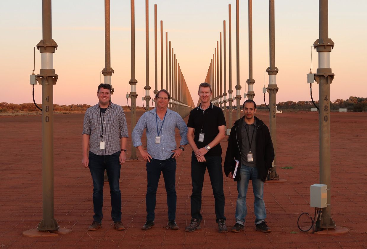 Image of Fred Baynes, Andre Luiten, Martin O'Connor, and Waddah Al-Ashwal, standing near the Jindalee Operational Radar Network.