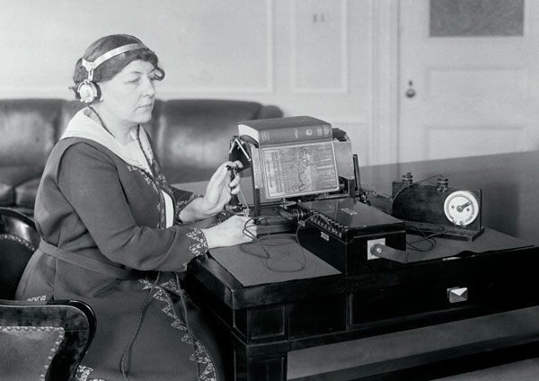 Margaret Hogan used the black sounding optophone to read a book.
