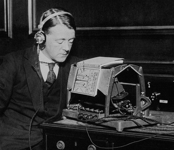 Man listening to an optophone