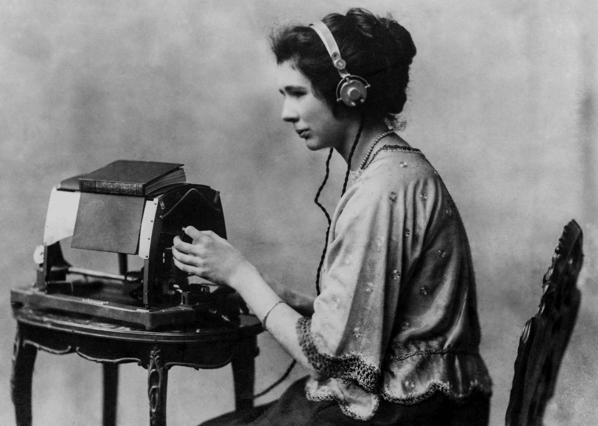 A woman listening to a device.