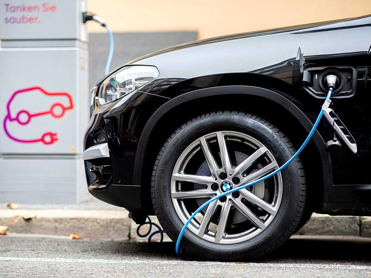 A car charging at a charging station.