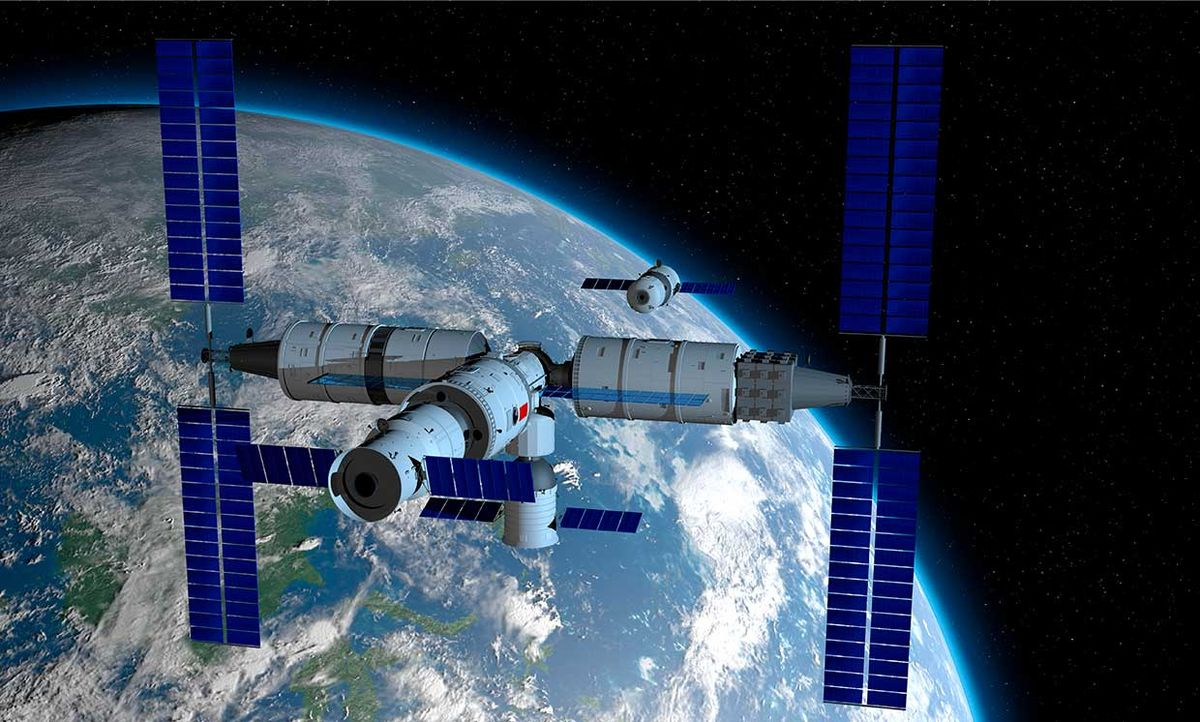Illustration conceptualizing Shenzhou manned space vessel in the direction of coupling to the TIANHE core module in TIANGONG 3 - Chinese space station with the planet Earth behind