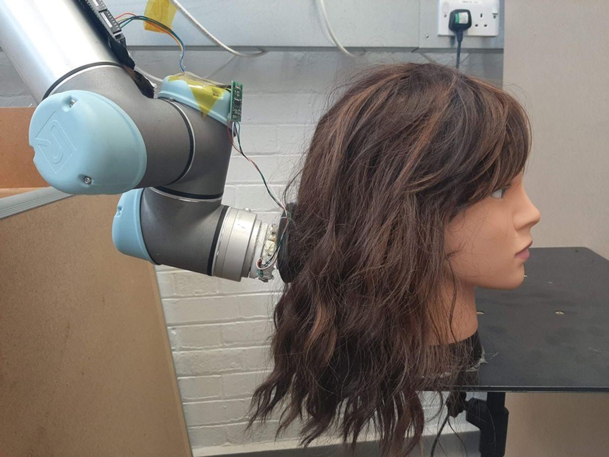 Robot hair brushing