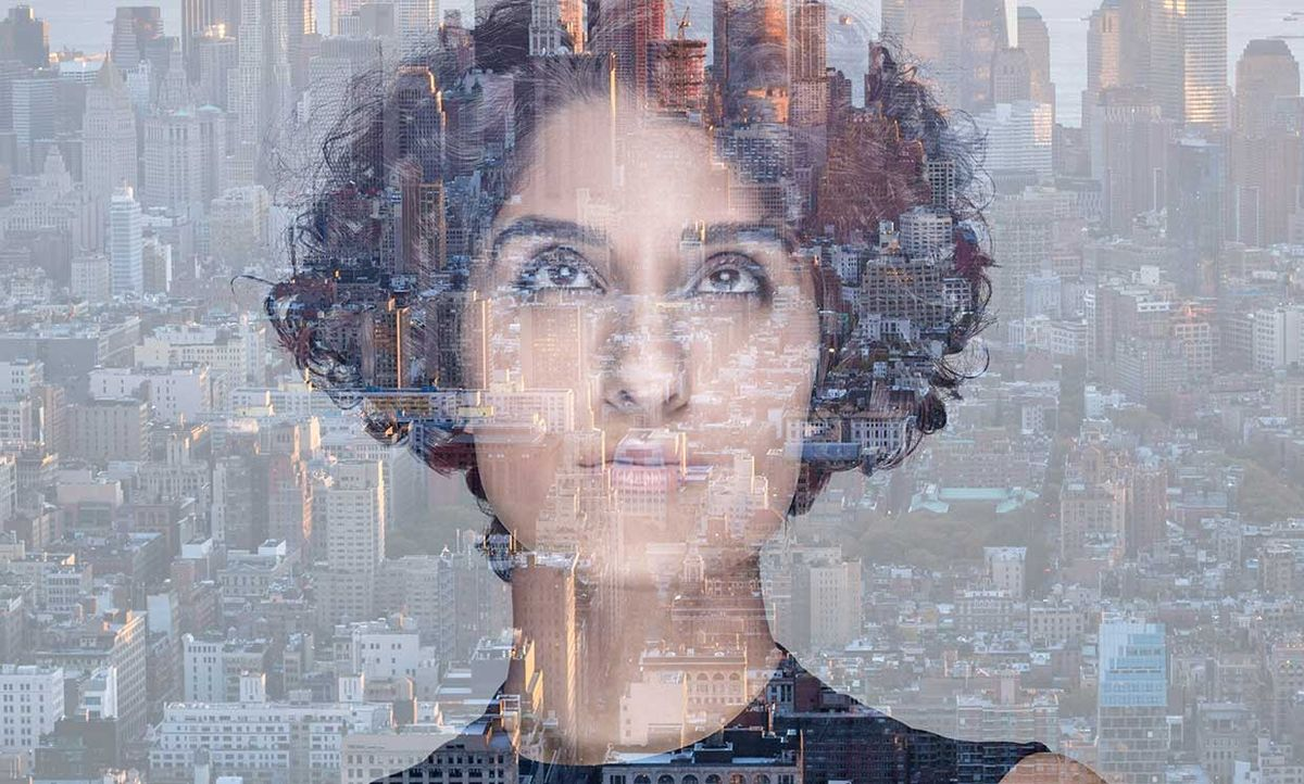 Double exposure of a woman and a city