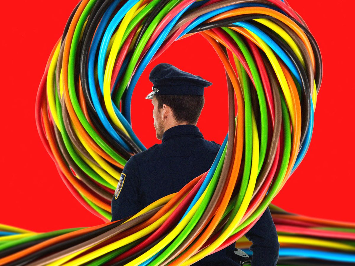 Image of a wire around a police officer.