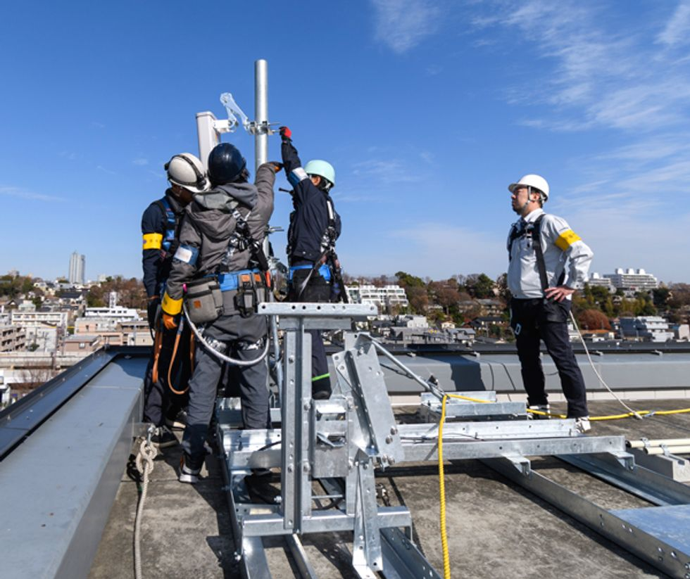 Image of workers on a rooftop.