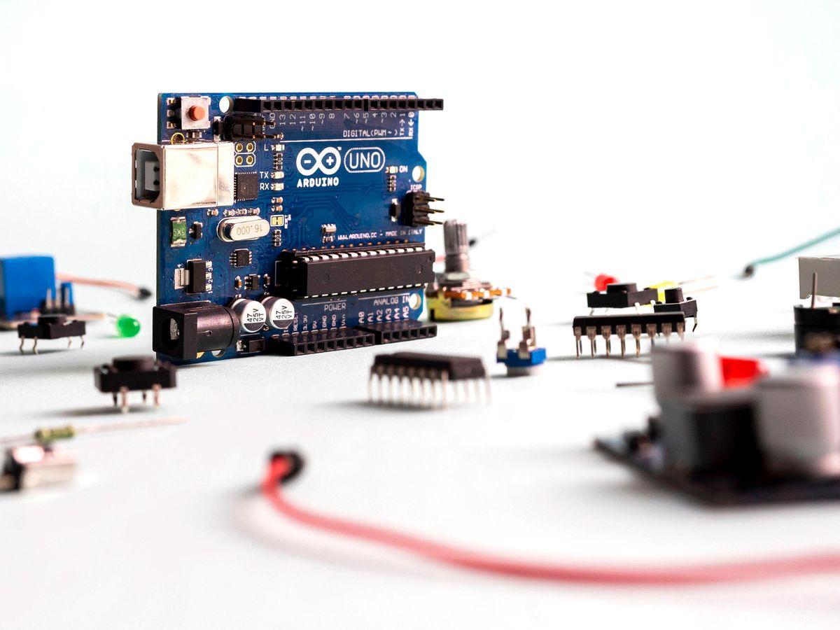 Arduino UNO board on light background.