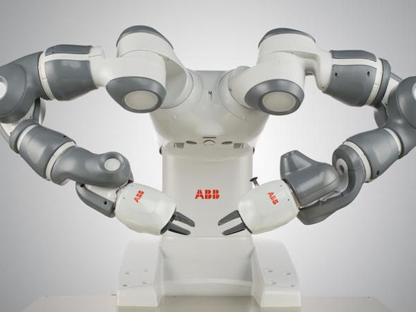 Photo of YuMi or related robot.