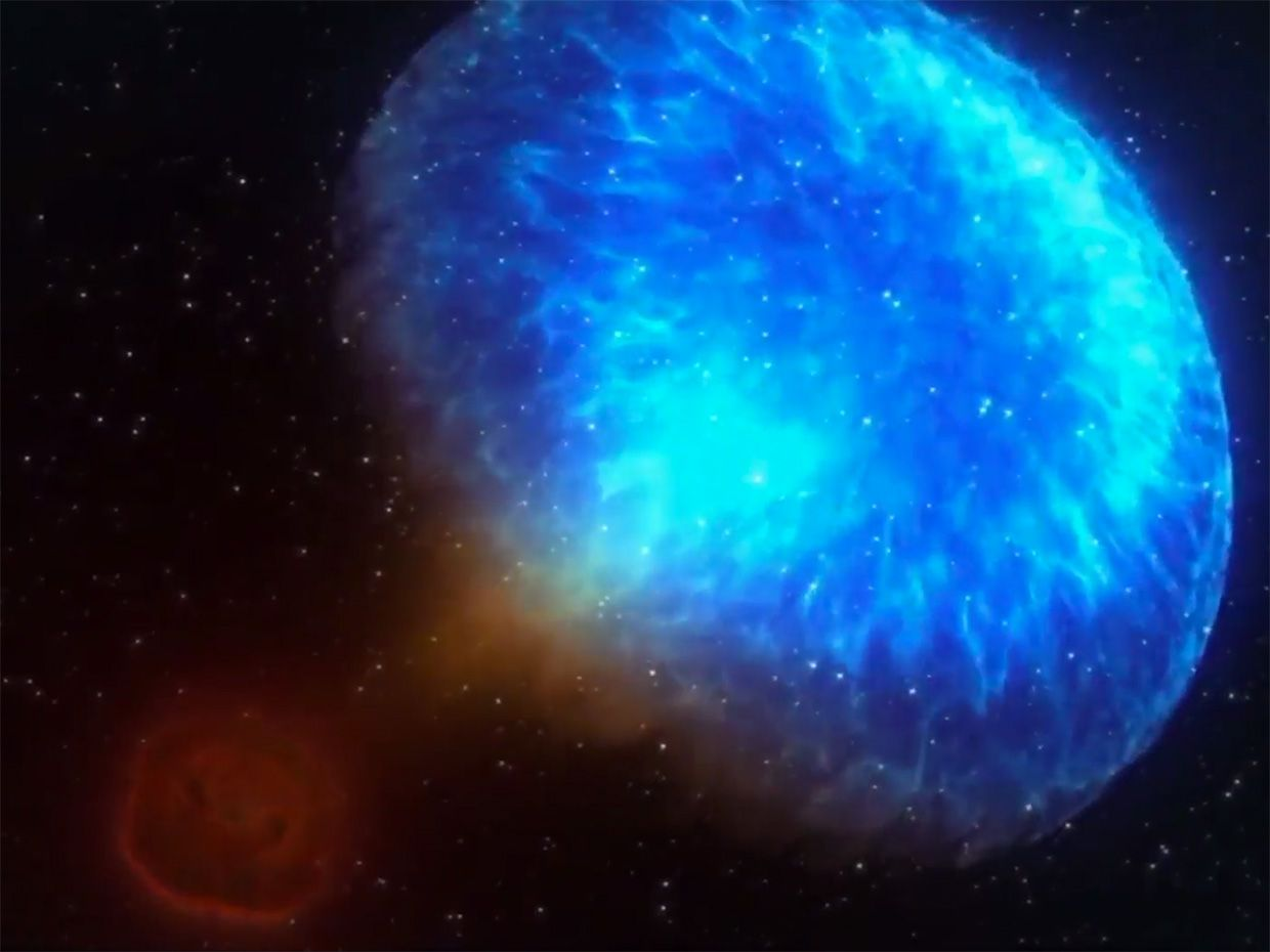 An illustration of a gamma-ray burst shows a blue cloud of bright light against a dark background.
