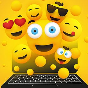 Illustration of a variety of emojis exploding out of a laptop.