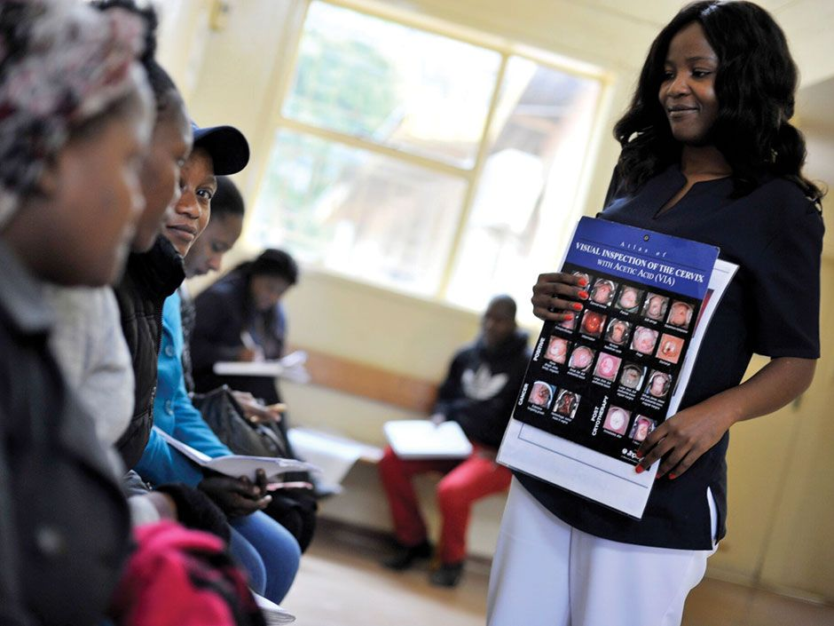 <b>Come One, Come All:</b> As part of a cervical cancer prevention campaign in six African countries, the nonprofit Pink Ribbon Red Ribbon works with local health clinics on special screening and education events, such as this one in Botswana.