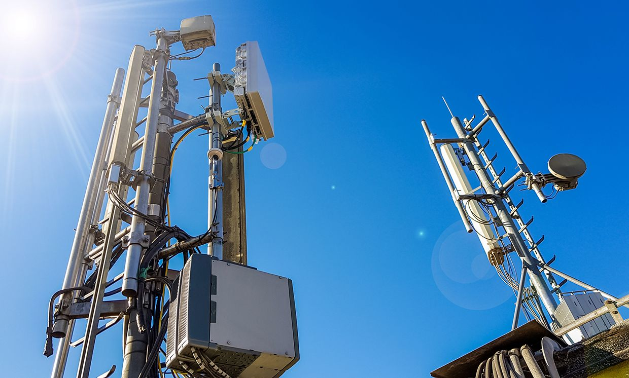The 5G Dilemma: More Base Stations, More Antennas—Less
