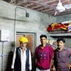 IIT engineers pose beside a microgrid controller
