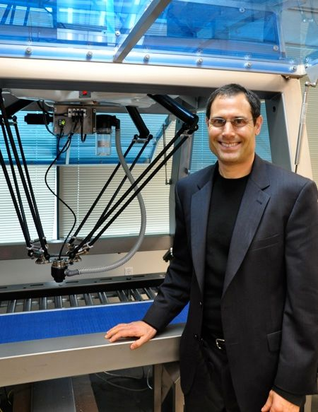 adept ceo john dulchinos with industrial robot
