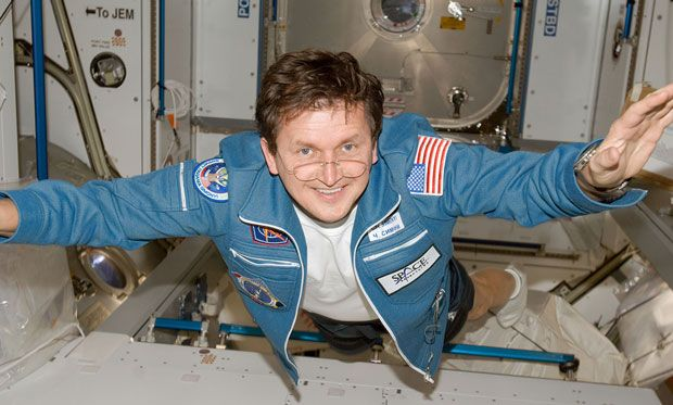 Photo of Charles Simonyi smiling while floating in the International Space Station.