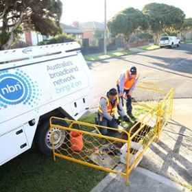 Photo of technicians installing a portion of Australia's National Broadband Network.