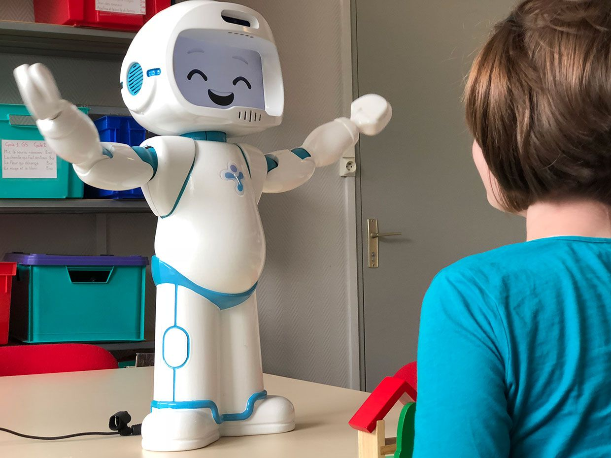 LuxAI's QTrobot with a child.