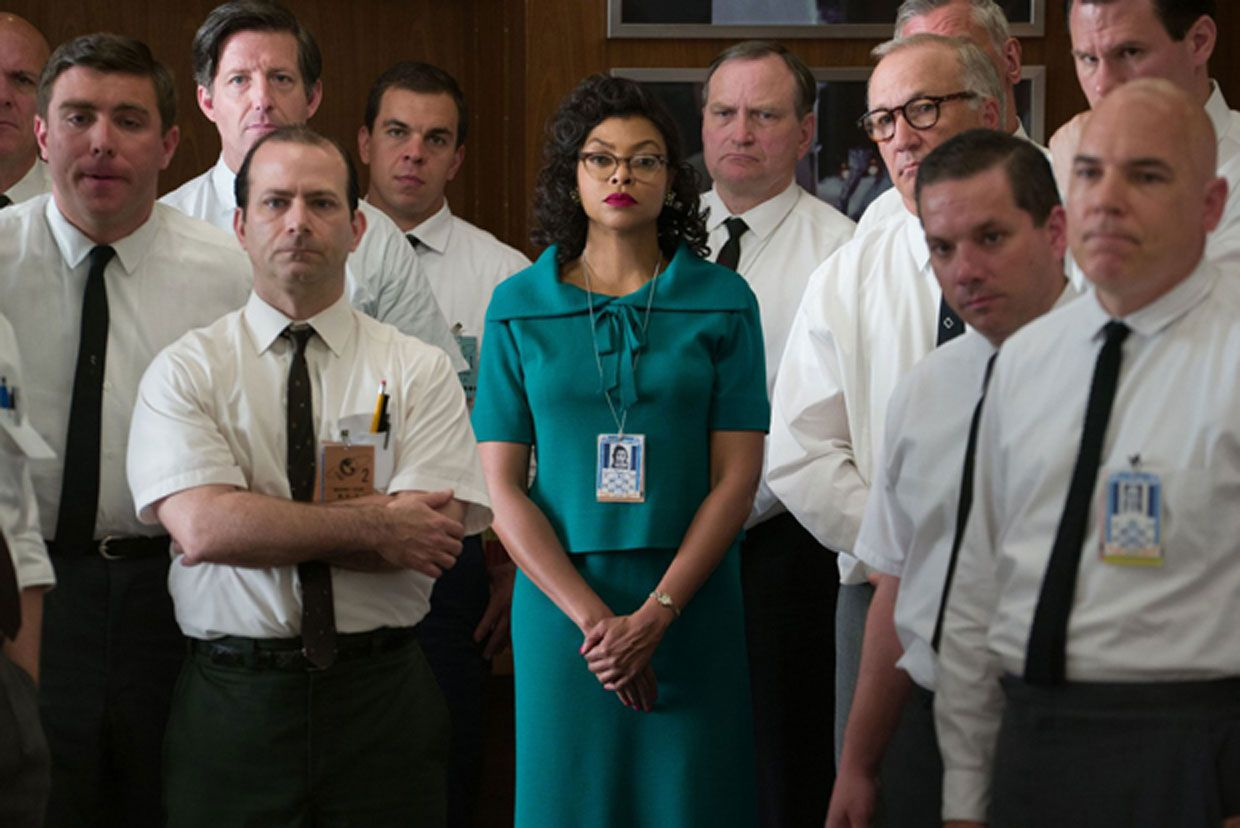 Katherine Johnson (center), played by actress Taraji P. Henson, worked at NASA as a mathematician, helping NASA launch its first successful manned mission around the Earth.