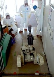 robot operators driving irobot warrior at fukushima dai-ichi nuclear power plant
