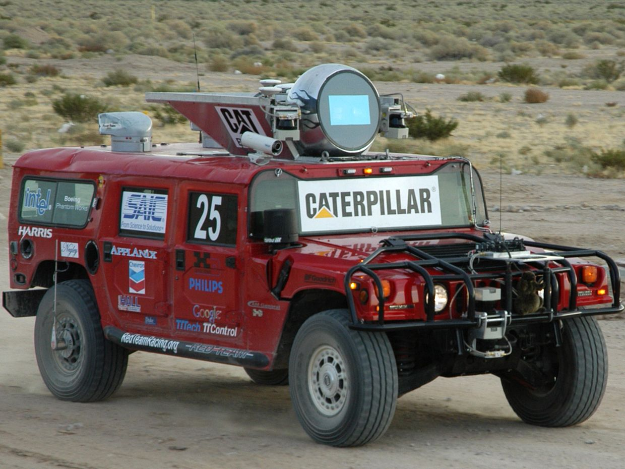 A photo of the red H1ghlander truck on a desert road.