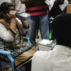 Photo of residents of Bangalore and Delhi, India, being provided with iris scan.
