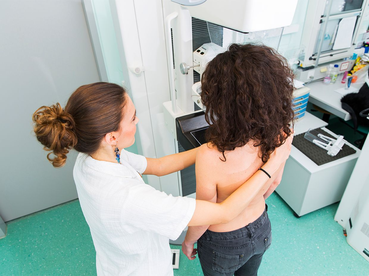 Women with a medical professional preparing to get a breast exam