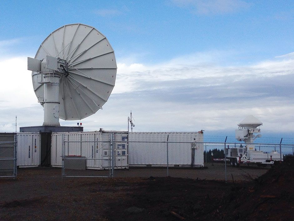 Two NASA radar stations—NPOL [foreground] and D3R [background]—took measurements on a hilltop in the Quinault Indian Reservation.