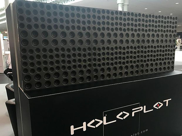 The Holoplot audio system, a large array of black speakers, looks like a large black rectangle with hundreds of depressions of different sizes within. It is displayed at CeBIT, an annual trade show in Hanover, Germany.