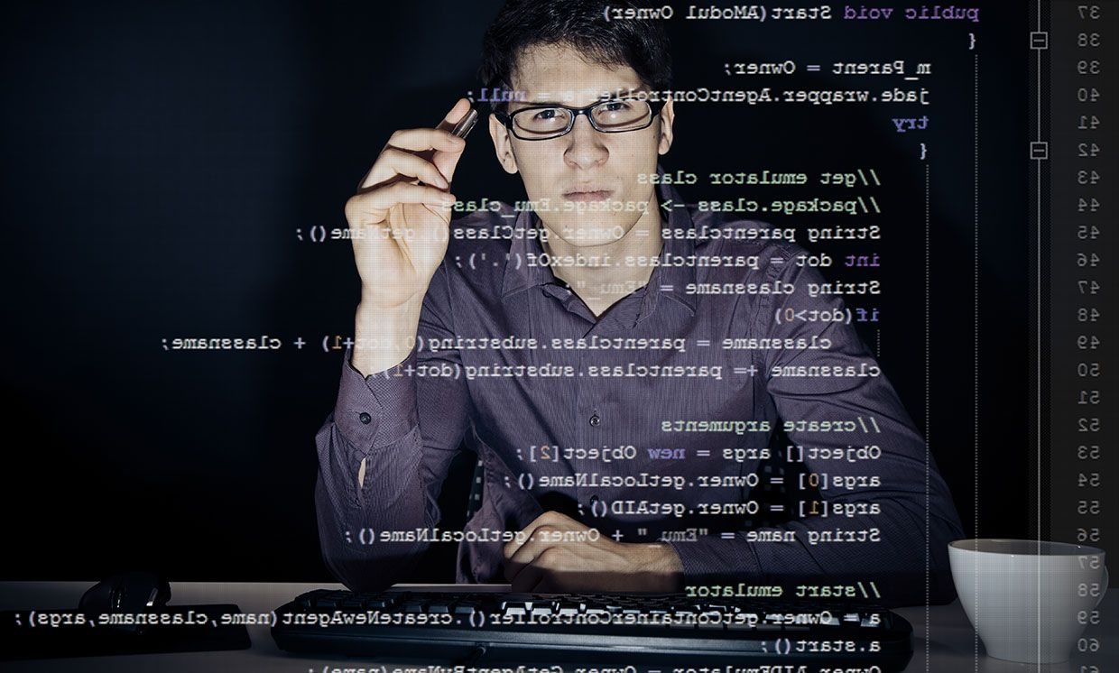 A man looking at Java code.