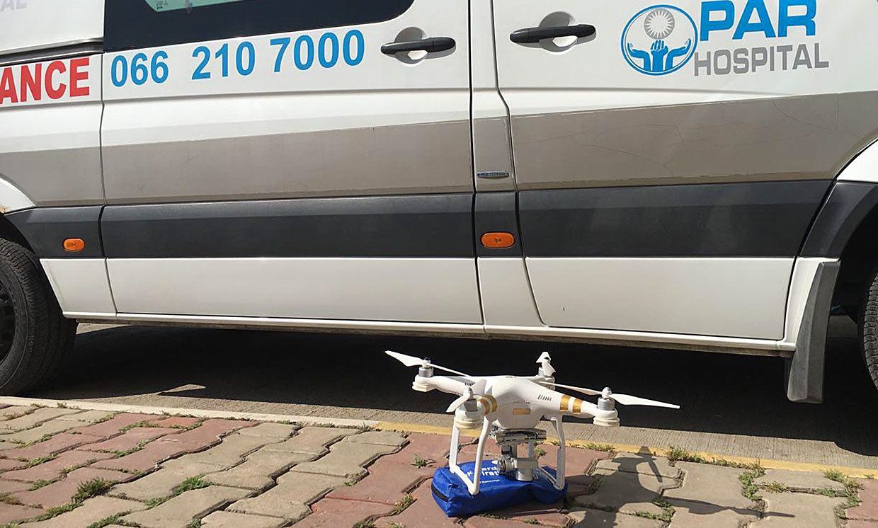 Photograph of the drone sitting in front of an ambulance.