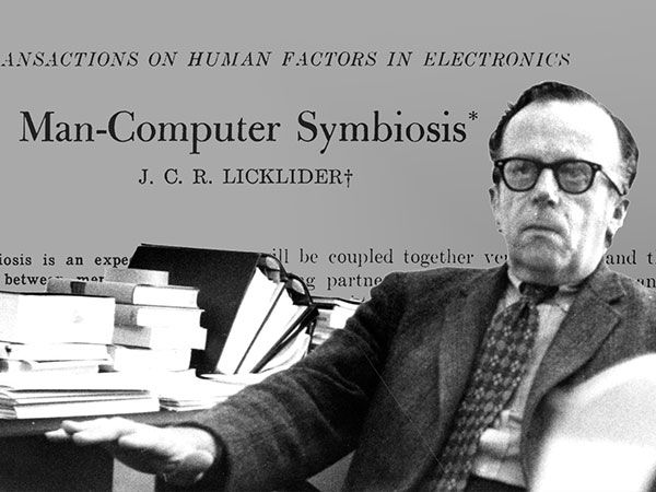 "Photo-illustration showing JCR Licklider at a desk with text from his1960 paper entitled ""Man-Machine Symbiosis"" in the image."
