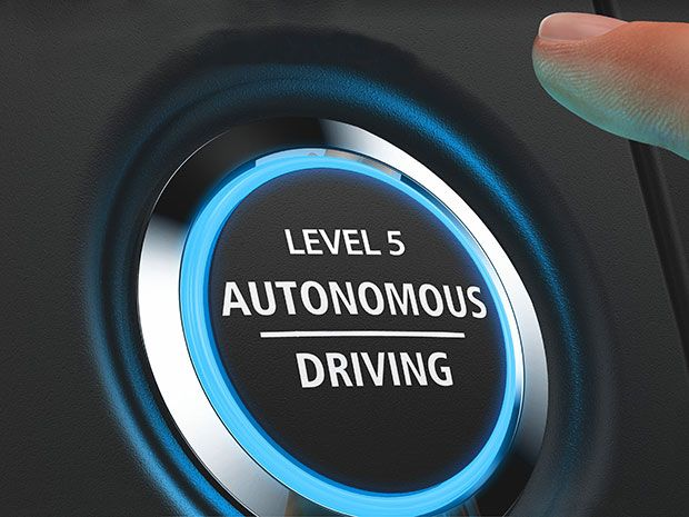 "A black button with a glowing blue halo that reads ""Level 5 Self-Driving""."