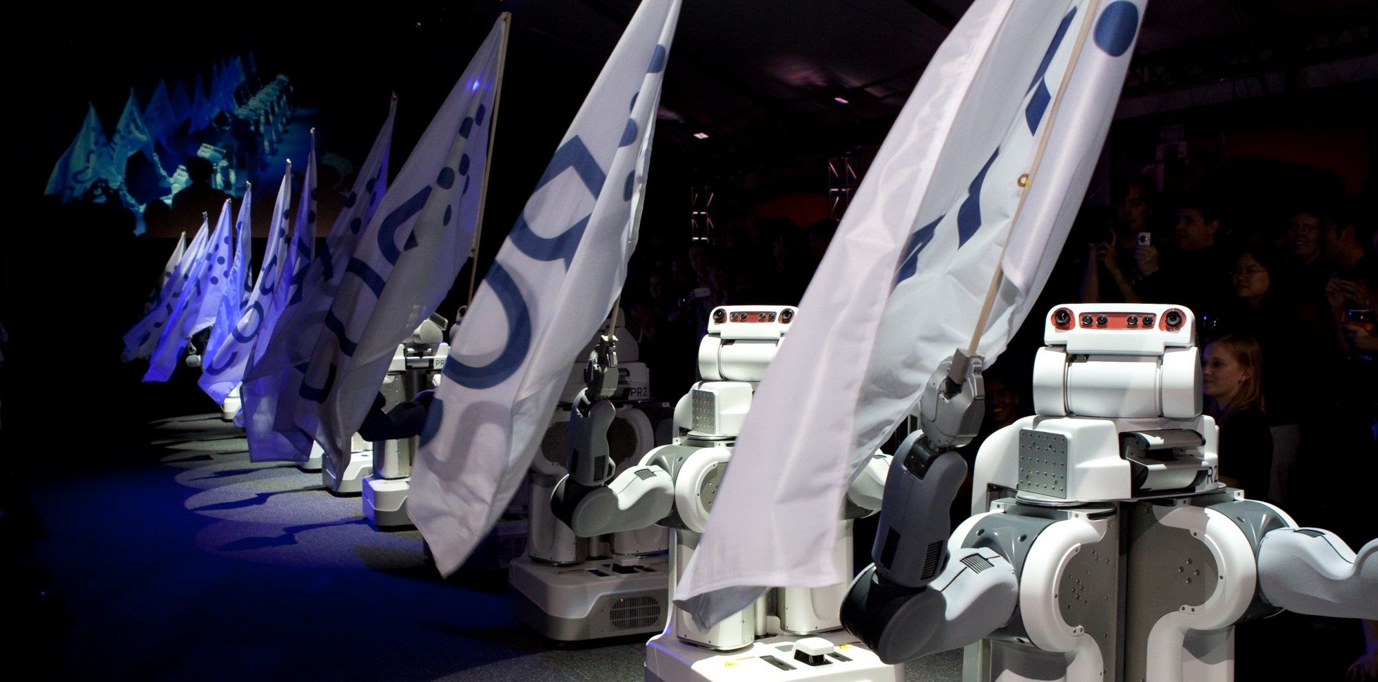 PR2 robots flying ROS flags in 2010.
