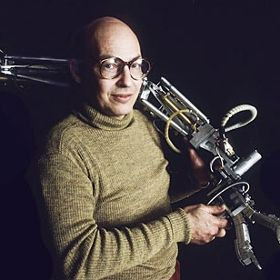 Mind and Machine: Marvin Minsky holds a 14-jointed, three-elbowed, computer-controlled, hydraulically muscled mechanical arm