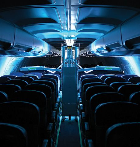 An airplane cabin being de contaminated using an UV light device