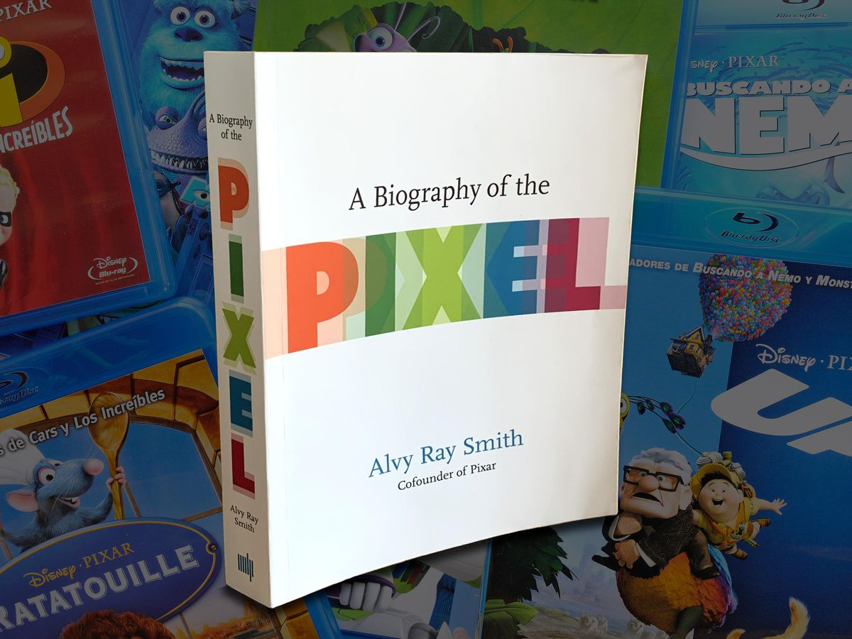The book A Biography of the Pixel by Alvy Ray Smith atop a background of Pixar Blu-Ray cases