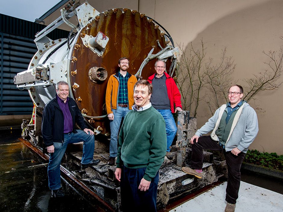 Authors Cutler [center], Peterson [left], Fowers [middle left], and Kramer [right], along with Microsoft Research's director of special projects, Norm Whitaker [middle right], celebrate a successful test.