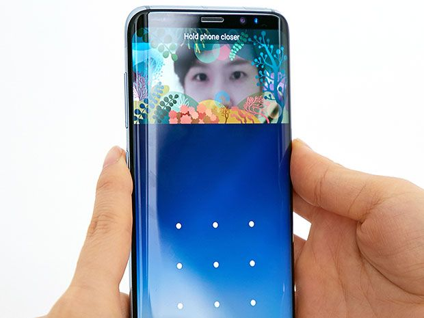 A person holds a new Samsung Galaxy S8 smartphone in front of their eyes to unlock their phone using iris scanning technology.