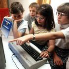 Kids try out a Commodore 64 in Nuremberg in May 1985.