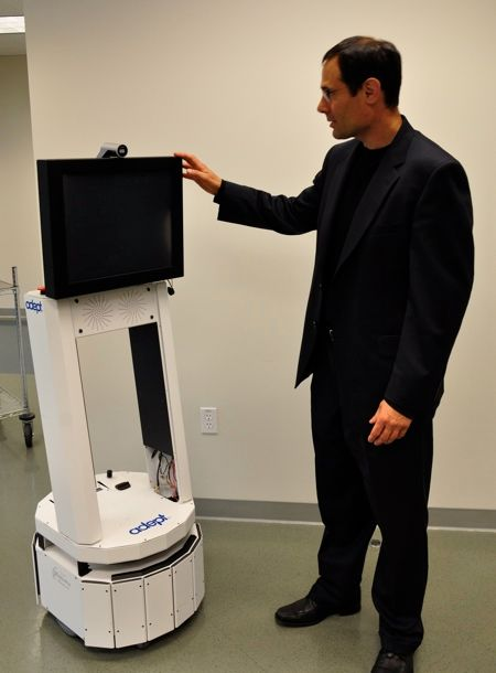 adept ceo john dulchinos with mobile robot
