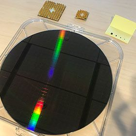 Intel's full silicon wafer of test chips, each containing up to 26-qubits, along with their 49-superconducting qubits chip Tangle Lake.