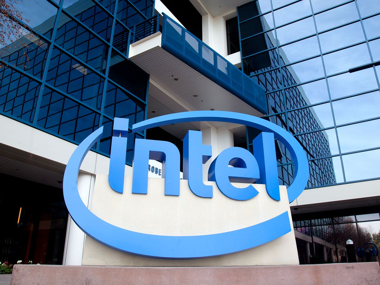 A photo shows the exterior of Intel's headquarters with the company's logo on prominent display.