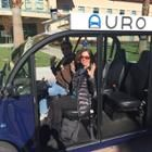 Spectrum senior editor Tekla Perry sits in what would be the drivers' seat, if Auro's self-driving shuttle at Santa Clara University had a driver
