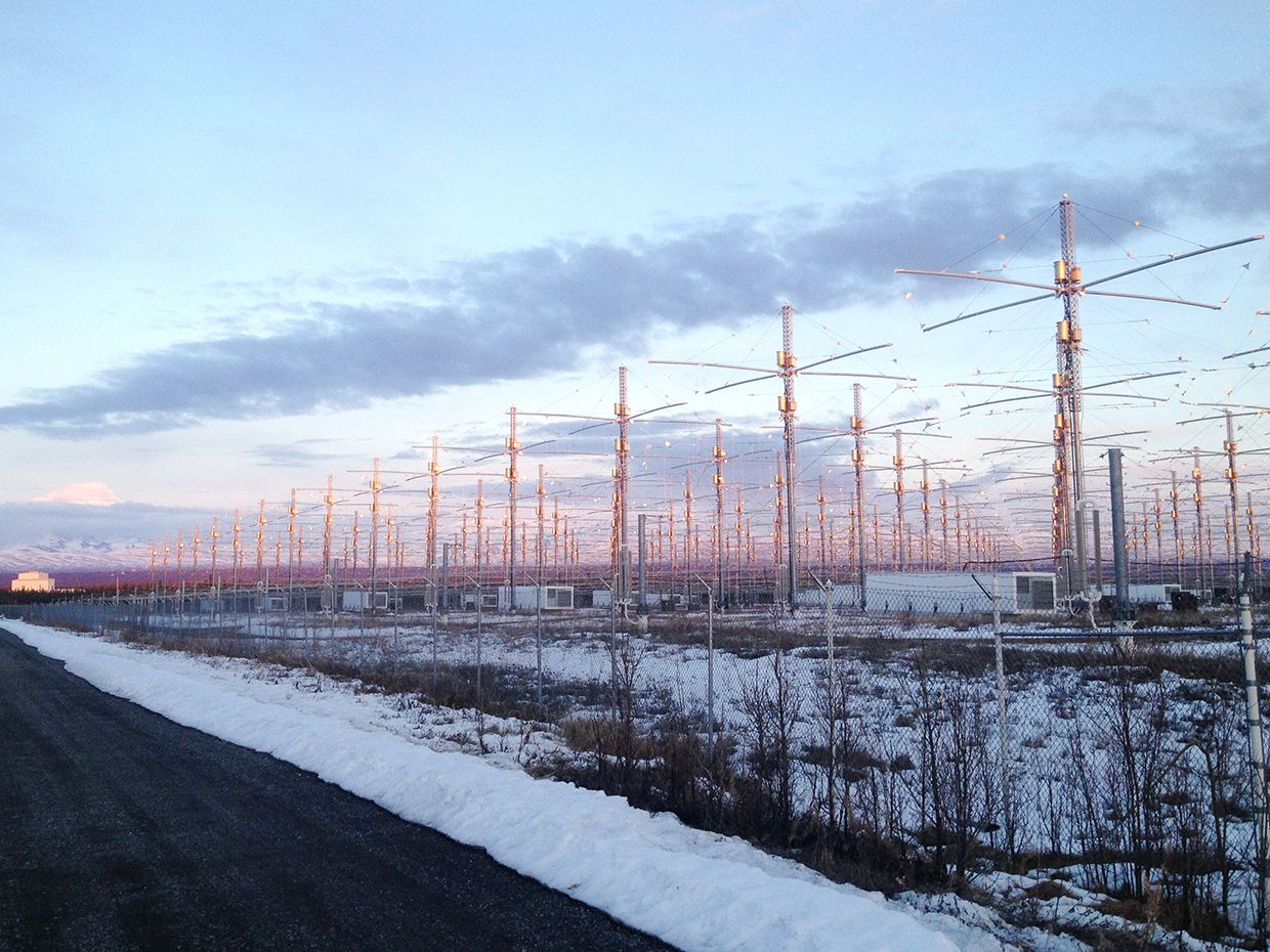 A photo of the HARRP antenna array lit up before a snowy lanscape at sunset.