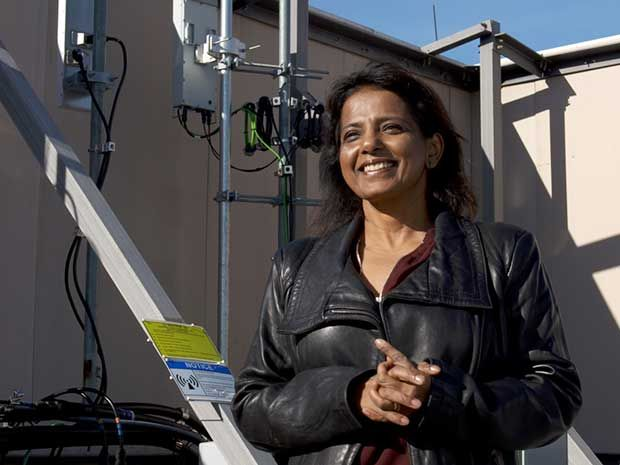 Sanyogita Shamsunder, Verizon's director of network planning, is shown standing outside near equipment used to test new base station technology.