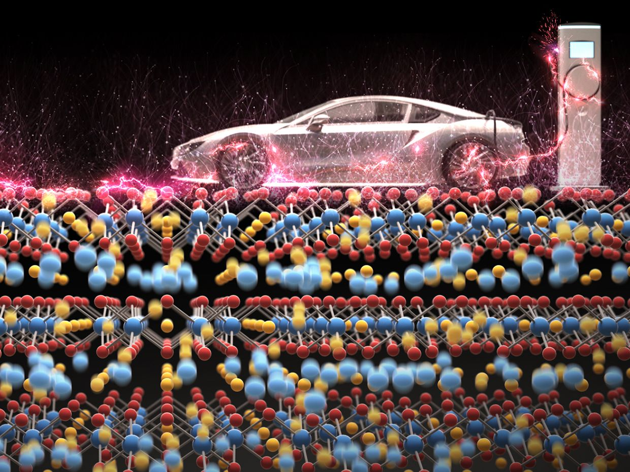 A photo illustration shows an electric car plugged into a charger sitting atop several rows of giant atoms on a black background.