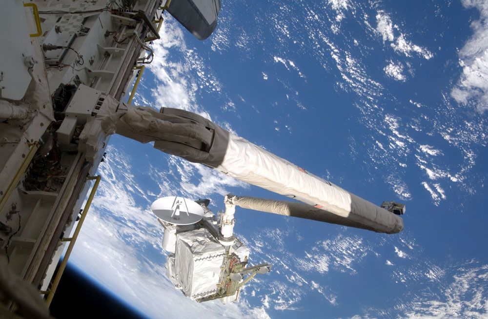 international space station pictures. A new ISS arm, Dextre,