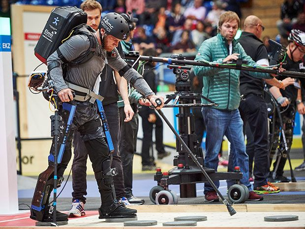 A paraplegic man wearing a robotic exoskeleton competes in a race during the Cybathlon, the world's first cyborg Olympics.