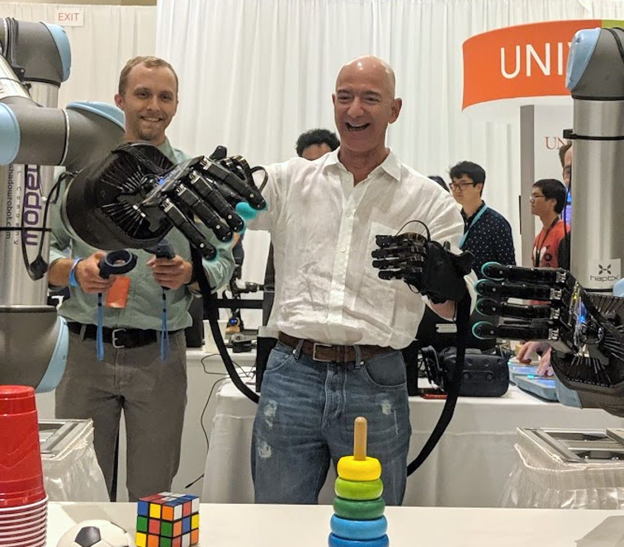 Amazon CEO Jeff Bezos tries dexterous robot hand at re:MARS conference