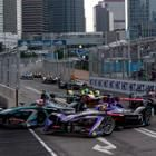 Formula E Season 3 began in Hong Kong. These four cars come around a tight corner.